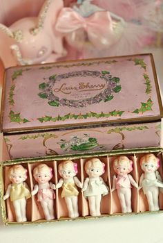 Can't you just imagine climbing the stairs to an old attic (in my imagination it's not too hot, too cold or dusty!) finding a lovely old trunk under a pile of perfectly preserved quilts, and opening the lid of a pink box inside to find these Vintage Dolls...i