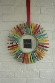 Katydid and Kid: Colorful Summer Clothespin Wreath {tutorial}--do I like this or don't I?  Hm...