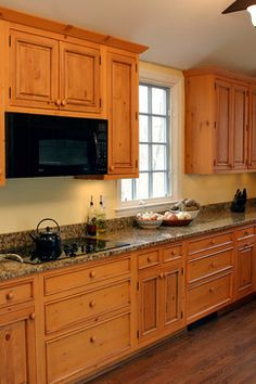 Knotty pine cabinets, granite counter-top - traditional - Kitchen - Dc Metro - Heritage Building and Renovation, Inc.