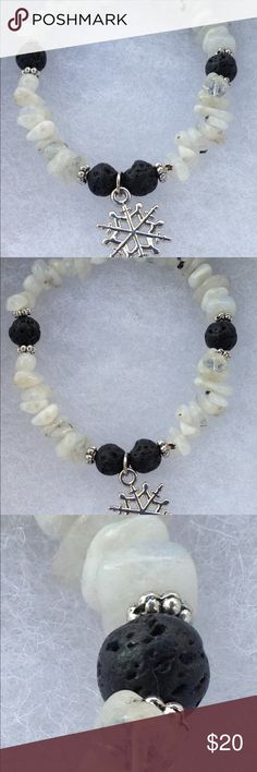 Moonstone and Lava Rock Snowflake Bracelet This beautiful bracelet is perfect for the upcoming winter! It is made with natural moonstone chips and black lava rock accents. The Snowflake charm is silver tone.   All PeaceFrog jewelry items are handmade by me! Take a look through my boutique for coordinating jewelry and more unique creations. PeaceFrog Jewelry Bracelets