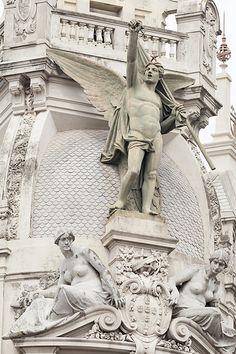 Porto - 85   Winged revolutionary angel on a building overlooking Avenida dos Aliados