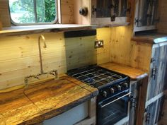 I love the cover for the sink so you can use the space to cook on as well. A 1980 Bedford TK Horsebox converted into a traveling tiny home house truck in The United Kingdom. Built by HouseBox.