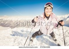 Ski. Happy female skier on the background of high snow-capped Alps in Swiss
