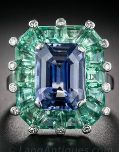 An Art Deco 5.68ct. Natural Sapphire, Green Beryl and Platinum Cocktail Ring. Mounted in platinum, circa 1930s-40s, centring a Ceylon blue emerald-cut sapphire, weighing 5.68 carats, framed by mint green beryl weighing 3.00 carats, dotted all around with small round diamonds. Unsigned but numbered. #ArtDeco #ring                                                                                                                                                                                 More