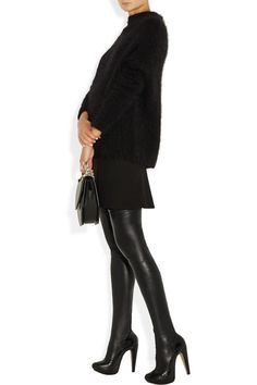 Polished heel measures approximately 130mm/ 5.5 inches with a 30mm/ 1 inch platform Black leather Stretch finish through leg, almond toe Pull on Designer color: Noir