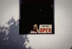 Girl in window by Lawrence Garwood, via Flickr