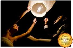 Sky Lanterns for your guest to launch at your reception.. such a neat idea!