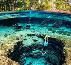 """<h3><a href=""""http://ginniespringsoutdoors.com/"""">Ginnie Springs</a></h3> <i>7300 Ginnie Springs Rd, High Springs, FL 32643; 2 hours, 5 minutes from Orlando</i> <br>Along with being one of Florida's most popular camping locations, Ginnie Springs has one of the clearest bodies of water in Florida. Snorkel, swim, canoe and kayak in seven different springs across the park or explore the hidden grottos beneath the water's surface. Certified divers can travel through 30,000 feet of passageways in…"""