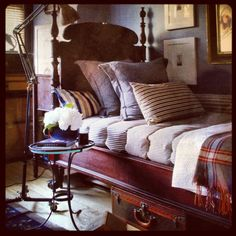 Antique Wooden Bed, mismatched Bedding, and Great Art Work create a Handsomely Inviting Bedroom, via Elle Decor.
