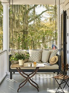The hanging daybeds at the Greyfield Inn in Georgia inspired the swings on a Southern home's upstairs veranda. Click through for more patio and outdoor room design ideas.