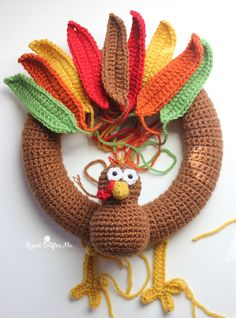 Free Pattern - Turkey Wreath - Gobble Gobble! It's Turkey Time! Celebrate November and the Thanksgiving holiday with this Crochet Turkey Wreath. A perfect piece of decor for your front door or inside walls. You can even take pieces of this pattern and make a free standing amigurumi suitable for a centerpiece! Materials: – Size G Crochet Hook – 10″ wreath …