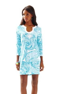 The Marlina dress is a printed t-shirt dress with sleeves.