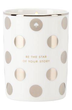 Silver metallic polka dots adorn this inspiring Kate Spade candle.