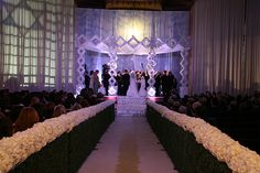 Isle lined with white flowers guiding the way #event #wedding #white  http://www.eventique.com/concept_category/wedding/