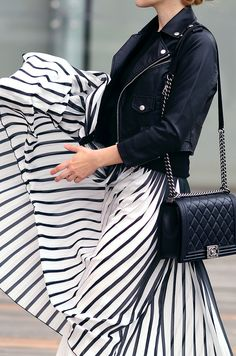 Back striped pleated maxi skirt and black bomber/moto jacket.