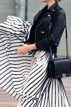Maxi skirt with stripes, black leather jacket and black Chanel Boy handbah