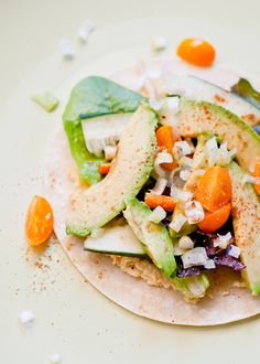 Hummus Avocado Tacos     Ingredients:  •4 corn tortillas (flour tortillas or pita)  •4 Tbsp. or more hummus  •a few handfuls baby lettuce or spinach  •1 ripe avocado, thinly sliced  •8-12 cherry tomatoes, cut into quarters  •1 carrot, cut into thin strips  •1/2 cucumber, cut into thin slices  •2 green onions, thinly sliced  •add cumin, chili powder, cayenne  • Lime or lemon juice