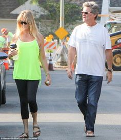 Who needs Bob The Builder? Goldie Hawn had handsome partner Kurt Russell by her side when . Goldie Hawn Kurt Russell, Bob The Builder, Los Angeles Homes, Neon Green, Handsome, Sporty, Actresses, Couples, Art