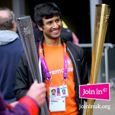 He looks pleased with his purchase. An Olympic & Paralympic torch - London 2012 Memorabilia Sale