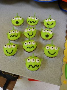 Toy Story Alien Cupcakes I made these with vanilla butter cream that I dyed bright green. The ears are green apple ripple ribbon candy cut...