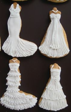 Instead of a bridal shower cake, these wedding dress cookies let guests choose their own style. Fancy Cookies, Iced Cookies, Biscuit Cookies, Cute Cookies, Royal Icing Cookies, Cupcake Cookies, Sugar Cookies, Owl Cookies, Wedding Dress Cookies
