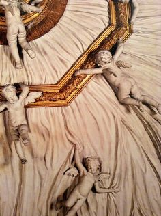 The square ball room with the magnificent stucco ceiling and 28 putti holding a large pleated veil, realized by Stazio at the end of XVII century, al Palazzo Albrizzi in S. Apollinare, in Venice. Detail.