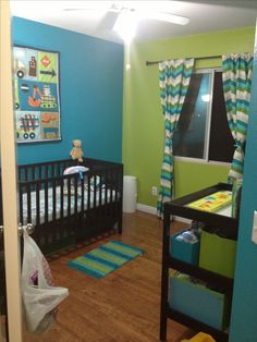 "Nursery designed for my Isaac who will be arriving in the next few weeks. Finally ready for ""move in day."" Paint colors are from the Disney Monster's Inc line at Walmart."