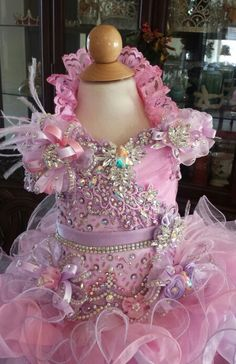For sale. Brand new!   Size 18 up to 3t.. Adjustable laced up back can fit up to a 22 inches chest. I will add laces and alter to fit perfectly.  Comes with a matching hair bow, bustle bow and detachable queen Ann collar. Message me if interested.  Ty  www.royaltydesigns.net