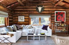 Inside the World's Chicest Log Cabin// Rustic living room with sectional sofa and log walls