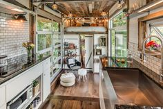 A custom tiny home with fold-down deck and sliding glass door. Built by David Latimer of New Frontier Tiny Homes in Nashville, Tennessee.