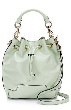 Loving everything mint this season | Rebecca Minkoff bucket bag.