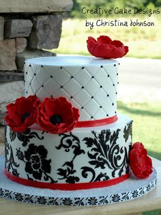 Striking red, white, and black cake with red anenomes