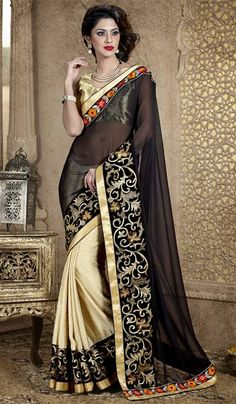Black off beige georgette jacquard wedding wear saree This half and half designer saree is beautified with dyed pallu portion and jacquard print patli portion zarri floral patch work on the saree along with resham zarri floral work patch on the borders of the pallu portion with glam to the zarri patch patti border on all over the saree.