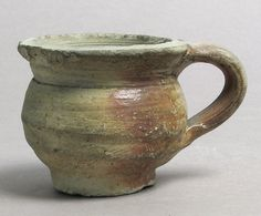 Cup Date: 15th century Culture: French Medium: Earthenware Dimensions: Overall: 2 1/4 x 2 1/2 in. (5.7 x 6.4 cm)
