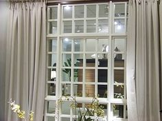 Lack of windows in basement? Solution: place a large mirror on a wall. Glue molding vertically and horizontally on mirror to make it look like a window. Install decorative curtain rod above and hang a pair of stylish drapes to finish the look. Basement lighting will bounce off the mirror (window) and reflect back into the room giving the illusion of a real window.