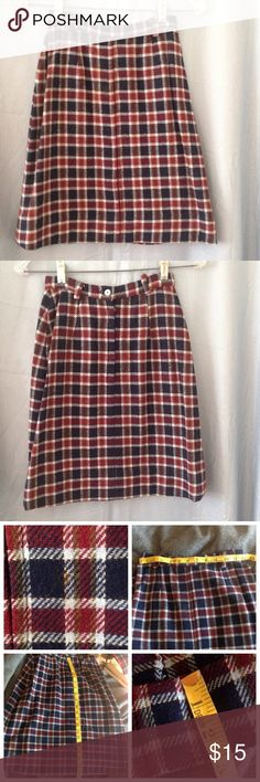 Cute vntg 60s/70s plaid miniskirt Cute plaid skirt zips up the back with with a button. 24 inch waist and is 20 inches long. No pockets. Has stain on front. See pic. looks like it was hemmed 2 1/2 inches. See pic. Country Set brand.  May have musty smell due to storage. Color may look different on your screen. Vintage Skirts Mini