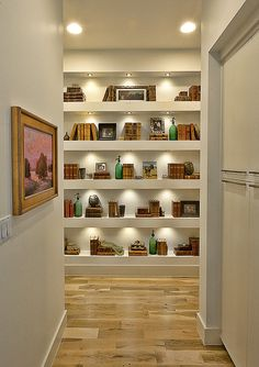 Cat Mountain Residence by Cornerstone Architects - I dream of a hallway lined with built-in bookshelves, but this one looks a little contrived, rather than a regularly-used and well-loved collection.