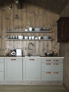 As much as I adore gourmet kitchens, I love charming, cozy, cottage kitchens just as much! I'm enamored with the stacks of bowls, plates and cups that are pl Cozy Kitchen, New Kitchen, Kitchen Dining, Kitchen Cabinets, Compact Kitchen, Grey Cabinets, Kitchen Wood, Kitchen Modern, Mini Kitchen