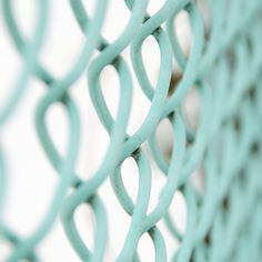 aqua chain link - sooooooo much prettier than the galvanized stuff! I might have to try this.....probably will take a gazillion spray cans, oh my!