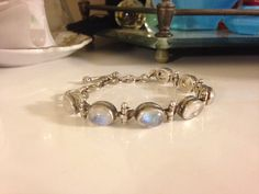I am selling an absolutely stunning vintage 1960s 8 Hand crafted stamped 925 sterling silver and genuine Moonstone adjustable toggle clasp