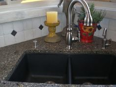 Looking to decide on black silgranite sink with tropical brown granite countertop and light backsplash. I think this decided for me. Yes!