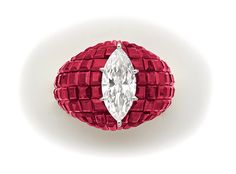 An Art Deco Marquise-cut diamond, invisibly set             ruby, gold and platinum ring.                          Van Cleef  Arpels, Paris.