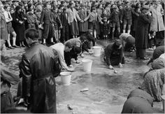 Viennese Jews are made to scrub the streets in humiliation after the German annexation of Austria, 1938