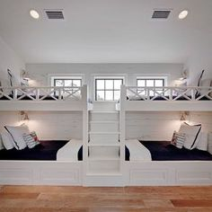 This bunk room was part of a much larger space. We designed and built these great bunks with four twin beds. I wanted it to be a space that would be comfortable for all ages and both boys and girls alike. A navy and white color scheme is both classic and crisp. The fun Otomi embroidered pillows add that fun pop of color on a sea blue cabana stripe.