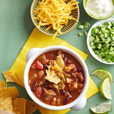 Chili Deluxe - Set out a toppings bar with cheesy crackers, avocado, green onions, cheese, [maybe bacon pieces - Nola] and more to complete this party-ready chili recipe.