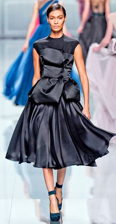 Joan Smalls in Dior-lovely It's beyond lovely it's gorgeous...love the flow of it.