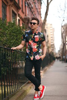 Shop this look on Lookastic:  https://lookastic.com/men/looks/black-floral-short-sleeve-shirt-black-chinos-red-low-top-sneakers/561  — Black Floral Short Sleeve Shirt  — Black Chinos  — Red Low Top Sneakers