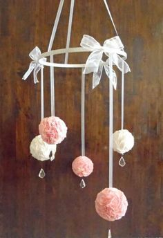 This beautiful fabric pom pom mobile will add some glitz and glam to any nursery. Perfect for your new bundle of joy. Makes a great gift! This mobile is made of three pink and two white fabric pom...