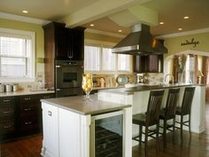 White cabinets, neutral backsplash, yellow walls.