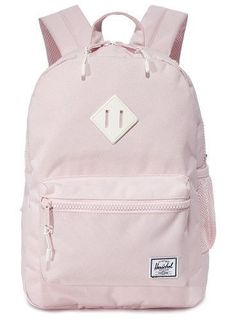 exclusive heritage backpack by Herschel Supply Co. A pastel-pink Herschel Supply Co. backpack with a mesh side pocket. A two-way zip opens to reveal the lined, two-pock. Mochila Jansport, Mochila Herschel, Herschel Rucksack, Jansport Backpack, Backpack Bags, Stylish Backpacks, Cute Backpacks, Girl Backpacks, Cute School Bags